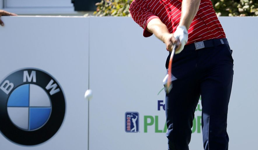 Jordan Spieth hits his drive on the third tee during the pro-am round of the BMW Championship golf tournament at Conway Farms Golf Club, Wednesday, Sept. 16, 2015, in Lake Forest, Ill. (AP Photo/Charles Rex Arbogast)