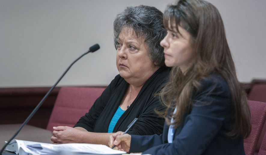 New Mexico Secretary of State Dianna Duran, left, sits with her attorney Erlinda Johnson during her arraignment on Tuesday, Sept. 15, 2015 in Santa Fe, N.M.  Duran pleaded not guilty Tuesday to fraud, embezzlement and other charges after being accused of funneling campaign contributions to her personal bank accounts and withdrawing large sums of money at casinos around the state.  (Eddie Moore/The Albuquerque Journal via AP) MANDATORY CREDIT