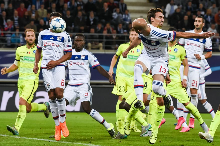 Lyon's Christophe Jallet, right, scores during the Champions League Group H soccer match between KAA Gent and Lyon at the Ghelamco Arena in Gent, Belgium, Wednesday, Sept. 16, 2015. (AP Photo/Geert Vanden Wijngaert)