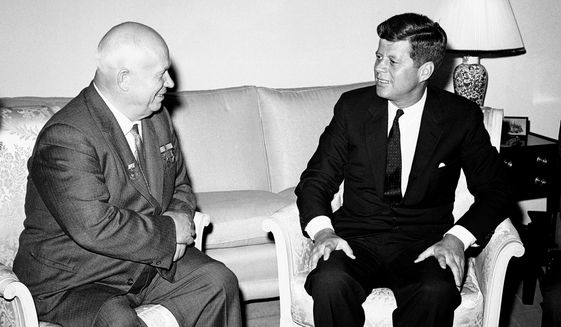 "In this June 3, 1961, Soviet Premier Nikita Khrushchev and President John F. Kennedy talk in the residence of the U.S. Ambassador in a suburb of Vienna. The meeting was part of  a series of talks during their summit meetings in Vienna. Fifty years after the Cuban missile crisis, the National Archives in Washington has pulled together documents and secret White House recordings to show the public how President John F. Kennedy deliberated to avert nuclear war. The exhibit opens Friday, Oct. 12, 2012, to recount the showdown with the Soviet Union. It is called ""To the Brink: JFK and the Cuban Missile Crisis."" (AP Photo/File)"