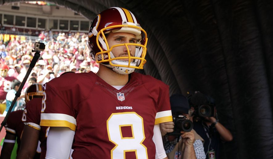 Washington Redskins quarterback Kirk Cousins (8) waits to be introduced before an NFL football game against the Miami Dolphins, Sunday, Sept. 13, 2015, in Landover, Md. (AP Photo/Mark Tenally)