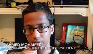 "Ahmed Mohamed, 14, was arrested and suspended from his Dallas-area high school on Monday after he brought a homemade clock to class and was accused of creating a ""hoax bomb."" (YouTube/The Dallas Morning News)"