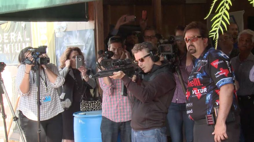 Surrounded by California supporters and sporting sunglasses, a sweatshirt and jeans, Sen. Rand Paul fired 10 shots from a semiautomatic rifle into a box filled with the voluminous federal tax code. Each shot cleanly hit its target. (TellDC)