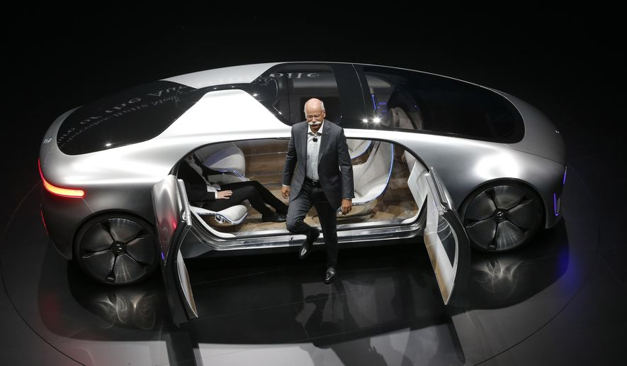 Daimler CEO Dieter Zetsche leaves an autonomous driving vehicle during an event of the Daimler group on the eve of the Frankfurt Auto Show IAA in Frankfurt, Germany, Monday, Sept. 14, 2015. (AP Photo/Michael Probst)