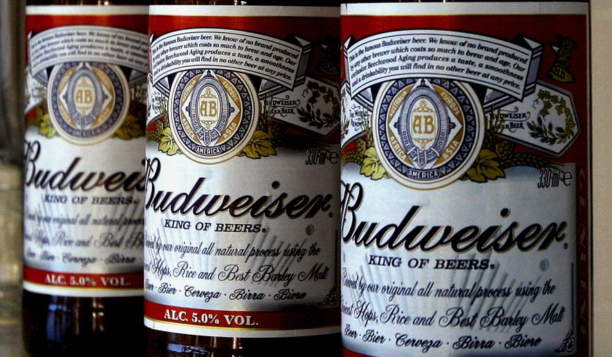 This Jan. 27, 2009, file photo shows bottles of Budweiser beer at the Stag Brewery in London. (AP Photo/Kirsty Wigglesworth, File)
