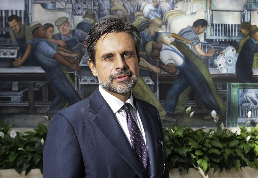 Salvador Salort-Pons, stands in the Diego Rivera court after being introduced as the Detroit Institute of Arts director, Wednesday, Sept. 16, 2015 in Detroit. Salort-Pons was executive director of collection strategies and information who played a key role in the museum's strategic planning process. The museum's board named the 45-year-old, who has served as director of the museum's European Art Department since 2011, as director, president and CEO effective Oct. 15. (AP Photo/Carlos Osorio)