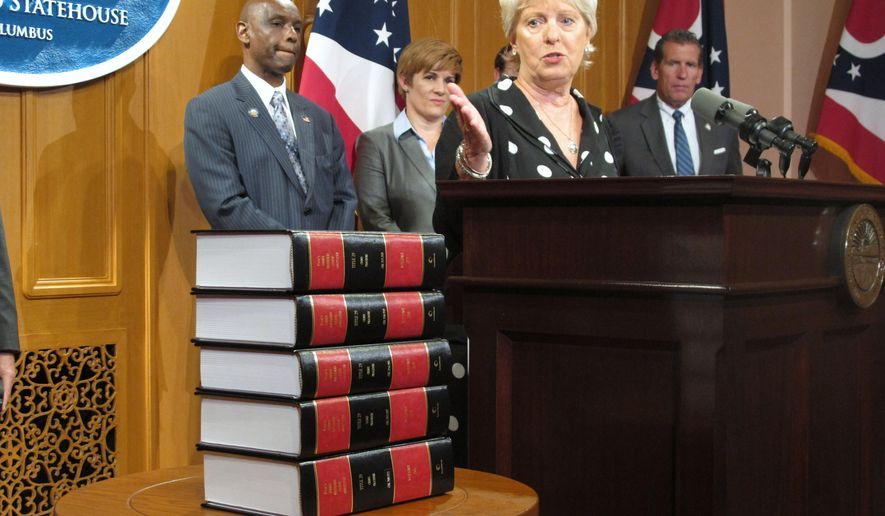"""FILE - In this Thursday, Sept. 10, 2015, file photo, Ohio Supreme Court Justice Judith Ann Lanzinger speaks during a news conference in Columbus, Ohio. In a Tuesday, Sept. 15, 2015, ruling in a contract dispute with Akron-based charter school administrator White Hat Management, the Republican judge nudged state lawmakers to consider whether tougher regulations are needed for charter schools, referred to as community schools in Ohio, writing the """"legislature enacted statutes that take a laissez-faire attitude toward operators of community schools."""" (AP Photo/Andrew Welsh-Huggins, File)"""
