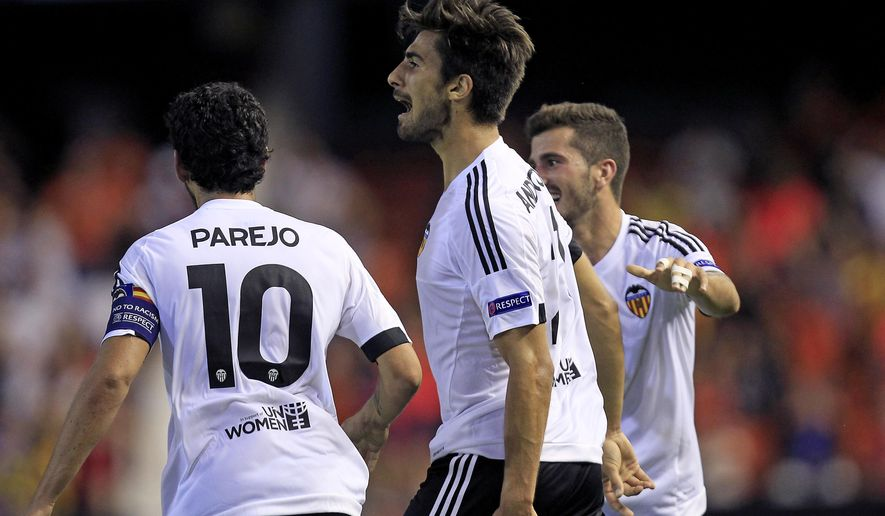 Valencia's Andre Gomes celebrates after scoring against Zenit during the Group H Champions League soccer match between Valencia and Zenit Saint Petersburg, at the Mestalla stadium in Valencia, Spain, Wednesday,  Sept. 16, 2015. (AP Photo/Alberto Saiz)