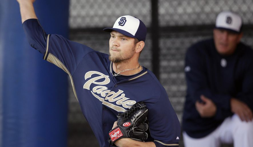 FILE - In this Sunday, Feb. 16, 2014 file photo, San Diego Padres pitcher Josh Johnson throws in the bullpen during spring training baseball practice on in Peoria, Ariz. The San Diego Padres said Wednesday, Sept. 16, 2015, right-hander Josh Johnson, who has been sidelined for two seasons, will have a third reconstructive elbow surgery  (AP Photo/Tony Gutierrez, File)