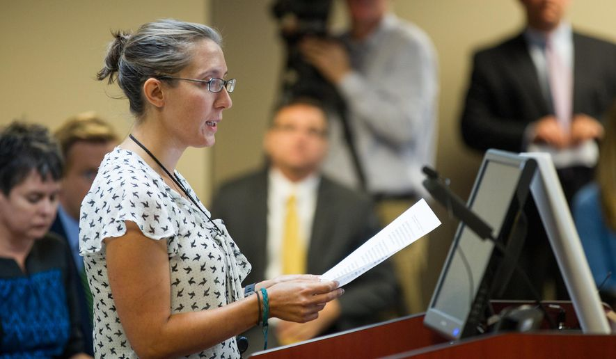 Andrea Zelinski, the news editor of the Nashville Scene and the president-elect of the state chapter of the Society of Professional Journalists, speaks at a hearing in Nashville, Tenn., on Wednesday, Sept. 16, 2015, in opposition to a legislative proposal to allow government officials to charge citizens to view public records. (AP Photo/Erik Schelzig)