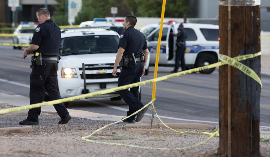 Phoenix police: Man accused of shooting officer was wanted