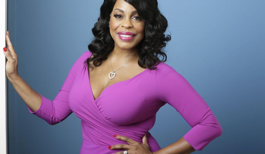 """In this July 30, 2015 photo, actress Niecy Nash poses for a photo in Los Angeles. Nash is nominated for an Emmy for best supporting actress in a comedy for the quirky HBO series """"Getting On.""""  (AP Photo/Damian Dovarganes)"""