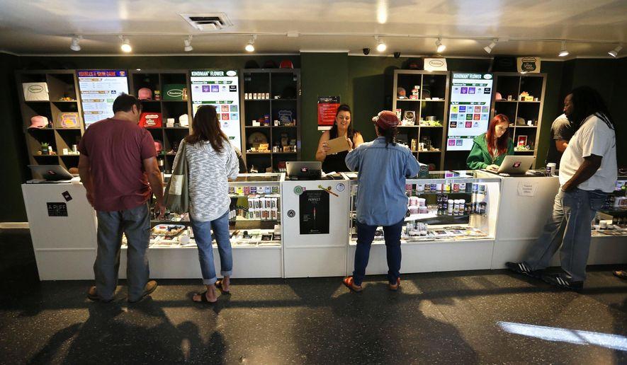 Customers shop for Marijuana inside The Grass Station recreational marijuana store, in Denver, Colo., Wednesday, Sept. 16, 2015. (AP Photo/Brennan Linsley)
