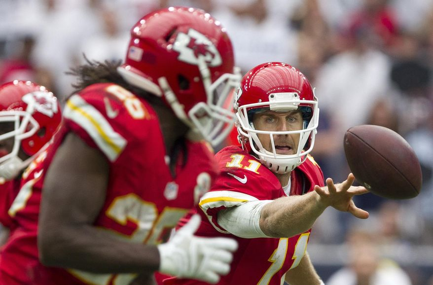 Kansas City Chiefs quarterback Alex Smith tosses the ball to running back Jamaal Charles during an NFL football game against the Houston Texans, Sunday, Sept. 13, 2015, in Houston. (Jason Fochtman/Conroe Courier via AP) MANDATORY CREDIT