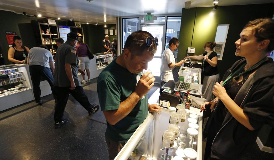 Customers shop inside The Grass Station recreational marijuana store in Denver, Colo., Wednesday, Sept. 16, 2015. (AP Photo/Brennan Linsley) ** FILE **