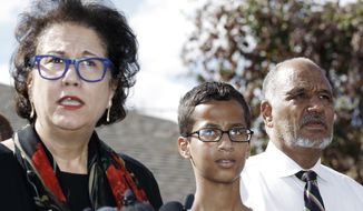 Ahmed Mohamed, 14, center, and his father Mohamed Elhassan Mohamed, right, look on as their attorney Linda Moreno, left, delivers a statement about the arrest of Ahmed during a news conference, Wednesday, September 16, 2015, in Irving, Texas. Ahmed was arrested after a teacher thought a homemade clock he built was a bomb. (AP Photo/Brandon Wade) ** FILE **