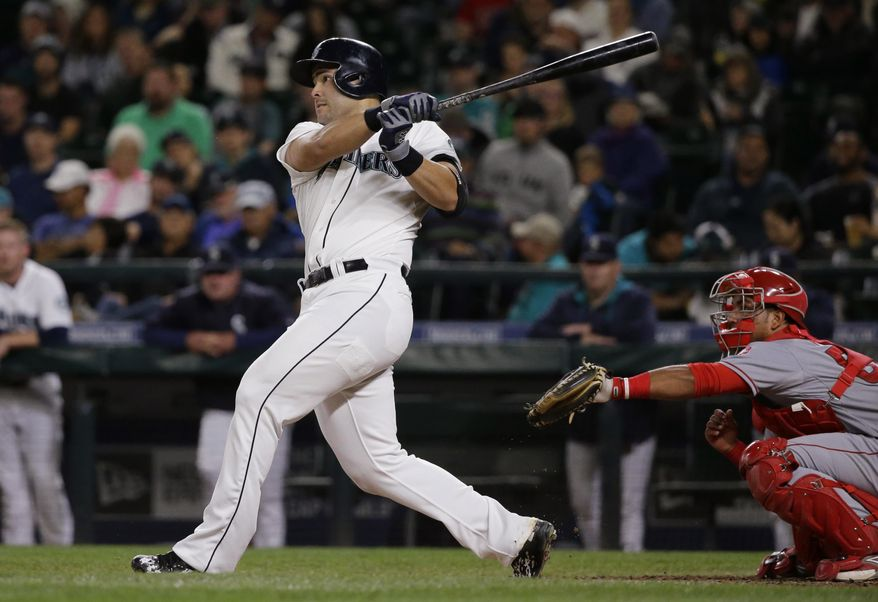 Seattle Mariners' Jesus Montero watches his three-run home run against the Los Angeles Angels during the fourth inning of a baseball game, Wednesday, Sept. 16, 2015, in Seattle. (AP Photo/Ted S. Warren)