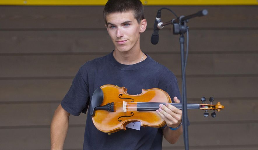 ADVANCE FOR SUNDAY SEPT. 20 - In this Aug. 5, 2015 photo, bluegrass fiddler Daniel Greeson of Jamestown performs at the 80th annual Old Time Fiddlers Convention in Galax, Va. (H.Scott Hoffmann/News & Record via AP) MANDATORY CREDIT