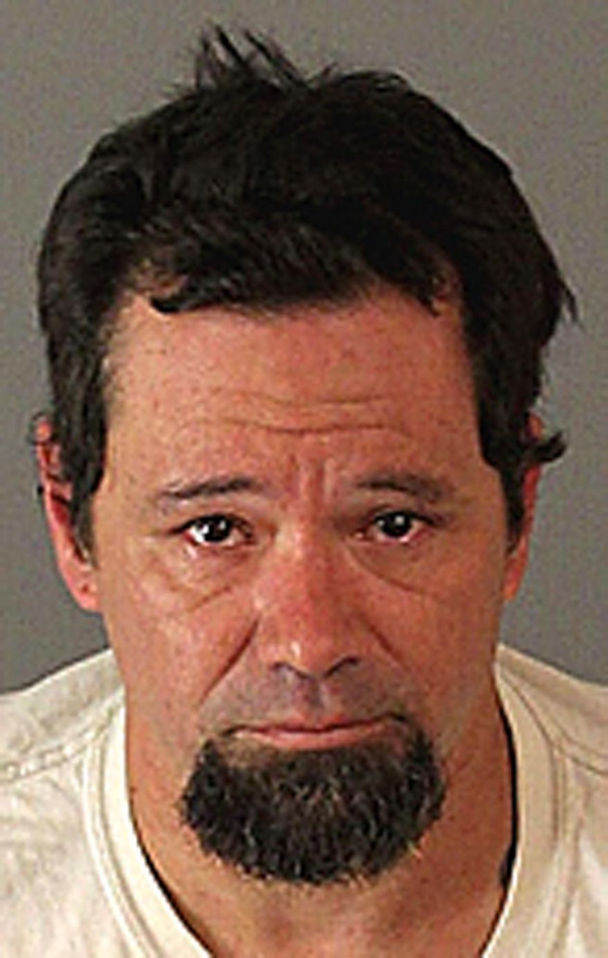 This undated booking photo provided by the Riverside County Sheriff's department show Jason Johnson who was taken into custody after allegedly breaking in to a Jurupa Valley, Calif., animal shelter and stealing dogs who were quarantined and waiting for hearings which could have caused them to be euthanized. The Press-Enterprise reports that Riverside County Sheriff's officials announced the suspect Wednesday, Sept. 16, 2015, in the break-in. (Riverside County Sheriffs Department via AP)
