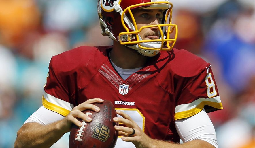 ADVANCE FOR SUNDAY, SEPT. 20 AND THEREAFTER  - In this photo taken Sept. 13, 2015, Washington Redskins quarterback Kirk Cousins looks for a receiver during an NFL football game against the Miami Dolphins in Landover, Md. (AP Photo/Patrick Semansky)