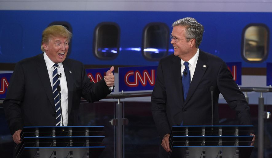 Republican presidential candidate, former Florida Gov. Jeb Bush, right, watches as Donald Trump speaks during the CNN Republican presidential debate at the Ronald Reagan Presidential Library and Museum on Wednesday, Sept. 16, 2015, in Simi Valley, Calif. (AP Photo/Mark J. Terrill)