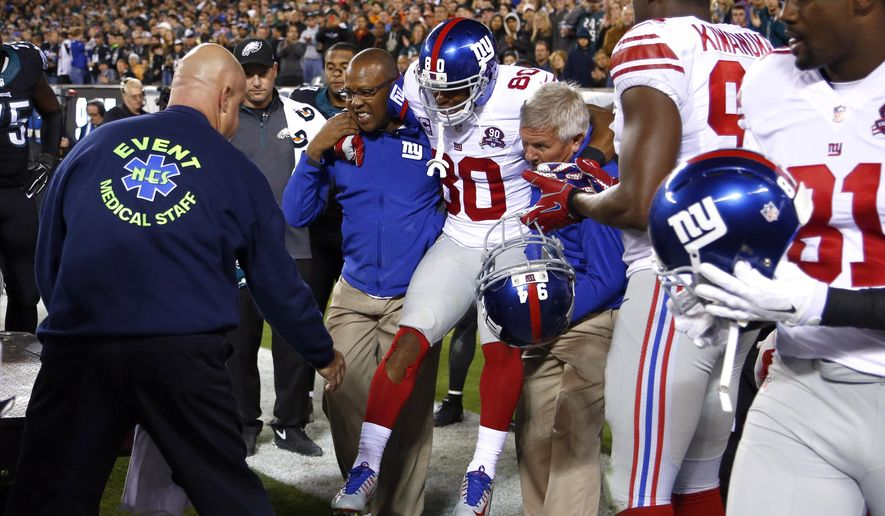 FILE - In this Oct. 12, 2014, file photo, New York Giants wide receiver Victor Cruz (80) is carried toward a cart after an injury during the second half of an NFL football game against the Philadelphia Eagles in Philadelphia. Sprains and strains. ACLs, MCLs and patellar tendons. In one painful instant, they can derail your favorite football team's championship hopes or sink your dreams for a title-winning fantasy football squad. (AP Photo/Matt Rourke, File)