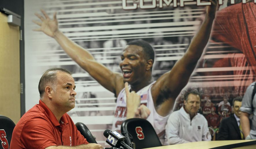North Carolina State assistant men's basketball coach Rob Moxley speaks with members of the media on campus in Raleigh, N.C., Thursday, Sept. 17, 2015.  Moxley is returning to coaching after being sidelined following a cardiac arrest which was caused by a diabetic condition. (AP Photo/Gerry Broome)