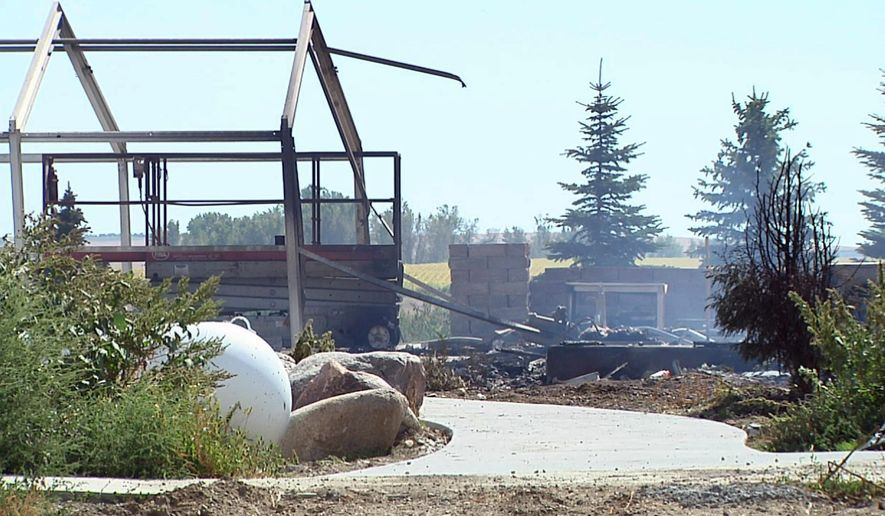 This frame from video provided by KELO-TV shows a home that burned down in a deadly fire south of Platte, S.D., Thursday, Sept. 17, 2015. Authorities said multiple people died. (KELO-TV via AP)