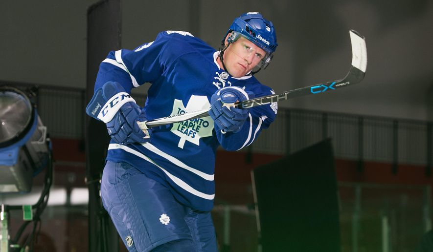 Toronto Maple Leafs NHL hockey player Dion Phaneuf takes part in a promotional video shoot in Toronto, Thursday, Sept. 17, 2015. (Darren Calabrese/The Canadian Press via AP) MANDATORY CREDIT