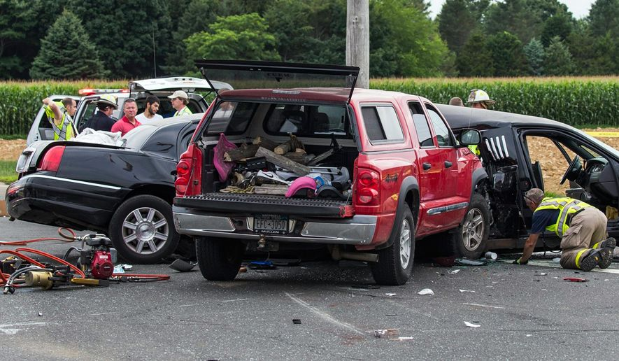 FILE - In this July 18, 2015 file photo authorities investigate the scene of a fatal crash between a limousine and a truck in Cutchogue, N.Y. Sen. Charles Schumer, D-N.Y., says the National Transportation Safety Board has agreed to investigate some limousine accidents, something it has rarely done in the past. The announcement follows this summer's fatal crash in Long Island wine country, when a pickup truck smashed into a limousine, killing four women. (Randee Daddona/Newsday via AP, File)