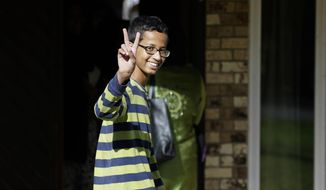 Ahmed Mohamed, 14, gestures as he arrives to his family's home in Irving, Texas, Thursday, Sept. 17, 2015. Ahmed was arrested Monday at his school after a teacher thought a homemade clock he built was a bomb. He remains suspended and said he will not return to classes at MacArthur High School. (AP Photo/LM Otero)