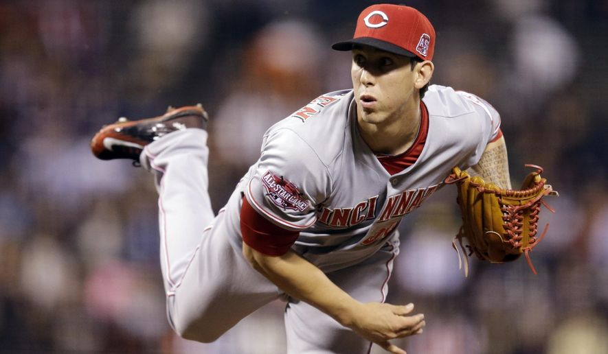 Cincinnati Reds pitcher Michael Lorenzen watches a delivery to the San Francisco Giants during the first inning of a baseball game Wednesday, Sept. 16, 2015, in San Francisco. (AP Photo/Ben Margot)