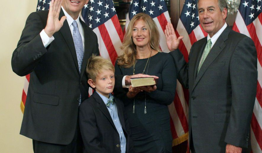 House Speaker John Boehner of Ohio administers the oath of office to Rep.-elect Darin LaHood, R-Ill., during a ceremonial swearing-in ceremony on Capitol Hill in Washington, Thursday, Sept. 17, 2015. LaHood is accompanied by his wife Kristen, and son Teddy, 8. Afterward LaHood was to be officially sworn into the House on the House floor.  (AP Photo/Lauren Victoria Burke)