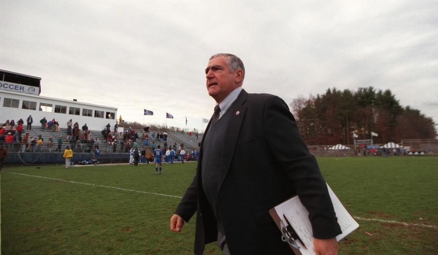 In this photo taken Nov. 10, 1996, Connecticut men's soccer coach Joe Morrone walks off the field after his team defeated Seton Hall in an NCAA college soccer game in Storrs, Conn.  The former UConn coach, a Hall of Famer who led the Huskies to the 1981 national title and the national semifinals the following two years, died Wednesday night, Sept. 16, 2015, at his Mansfield, Conn., home after a long battle with cancer, university officials said. He was 79. Morrone led the Huskies from 1969 to 1996 and was inducted into the National Soccer Coaches Association of America Hall of Fame in 2002. (David Roberts/Hartford Courant via AP) MANDATORY CREDIT