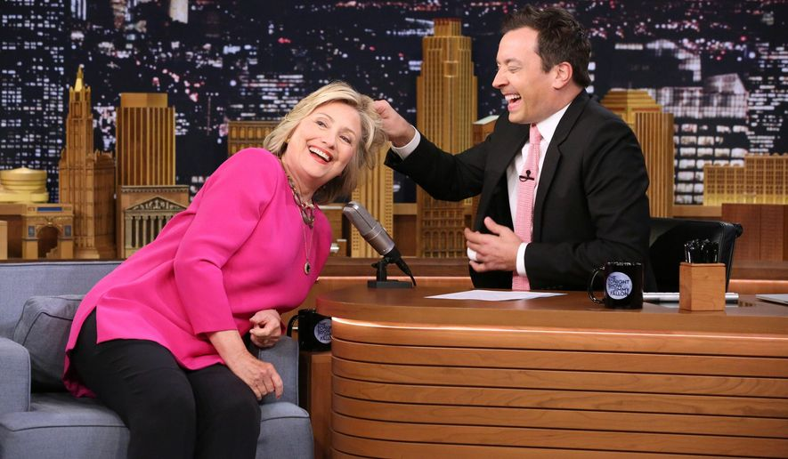 "In this image released by NBC, Hillary Rodham Clinton, left, invites host Jimmy Fallon to pull her hair during a taping of ""The Tonight Show Starring Jimmy Fallon,"" on Wednesday, Sept. 16, 2015, in New York. (Douglas Gorenstein/NBC via AP)"