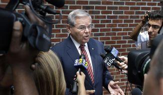 In this July 27, 2015, file photo, Sen. Robert Menendez, D-N.J., speaks to reporters in Union Township, N.J. (AP Photo/Mel Evans, File)