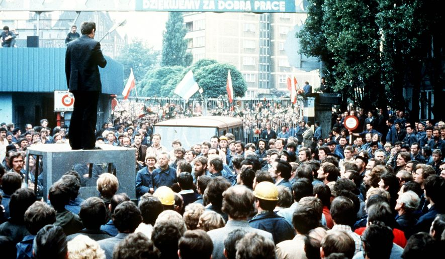 Hundreds stood outside the Lenin shipyard in Gdansk in northern Poland in August 1980 as striking workers held a series of meetings inside. Today the shipyard represents a flourishing industry for Poles. (Associated Press)