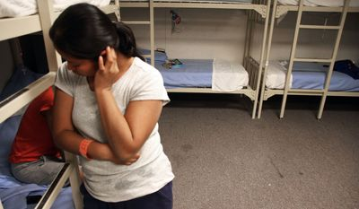 An unidentified Guatemalan woman is seen inside a dormitory in the Artesia Family Residential Center, a federal detention facility for undocumented immigrant mothers and children, in Artesia, N.M. (Associated Press)