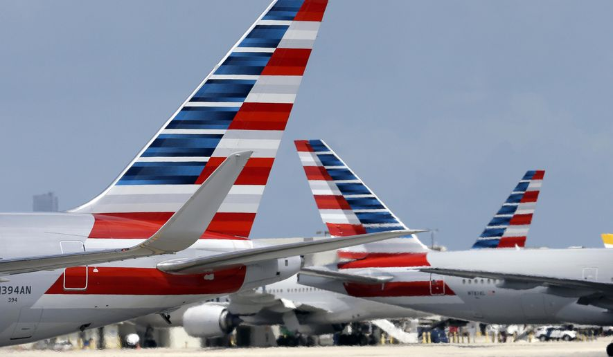 FILE - In this May 27, 2015 file photo, American Airlines aircraft taxi at Miami International Airport, in Miami. American Airlines says it has fixed a technology problem that was grounding flights to and from Dallas, Chicago and Miami on Thursday, Sept. 17, 2015. (AP Photo/Lynne Sladky, File)