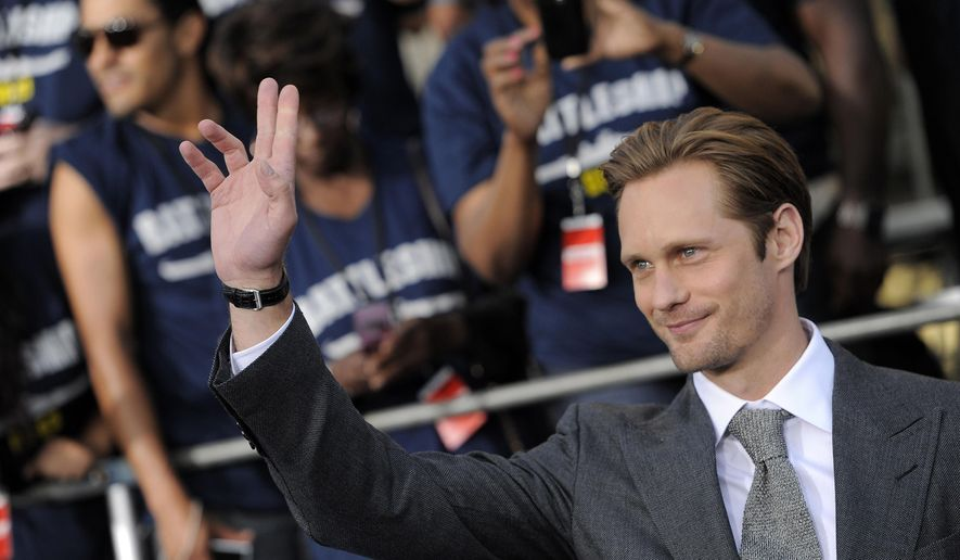 "FILE - In this May 10, 2012, file photo, Alexander Skarsgard, a cast member in the film ""Battleship,"" waves at the American premiere of the film in Los Angeles. Critics of Arctic offshore petroleum drilling have used climbing gear, kayaks and polar bear costumes to protest industrial activity in the Arctic. They're now trying humor. Actors Alexander Skarsgard, Jack McBrayer and Andy Bichlbaum are on a Greenpeace ship in the Greenland Sea with a team from Funny or Die to make the a comedy series focused on threats to the Arctic. (AP Photo/Chris Pizzello, File)"