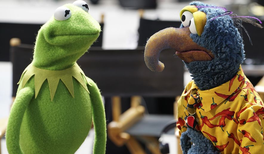 "In this image released by ABC, Kermit the Frog, left, and Gonzo the Great appear in a scene from ""The Muppets,"" which premiered Sept. 22. (Eric McCandless/ABC via AP)"