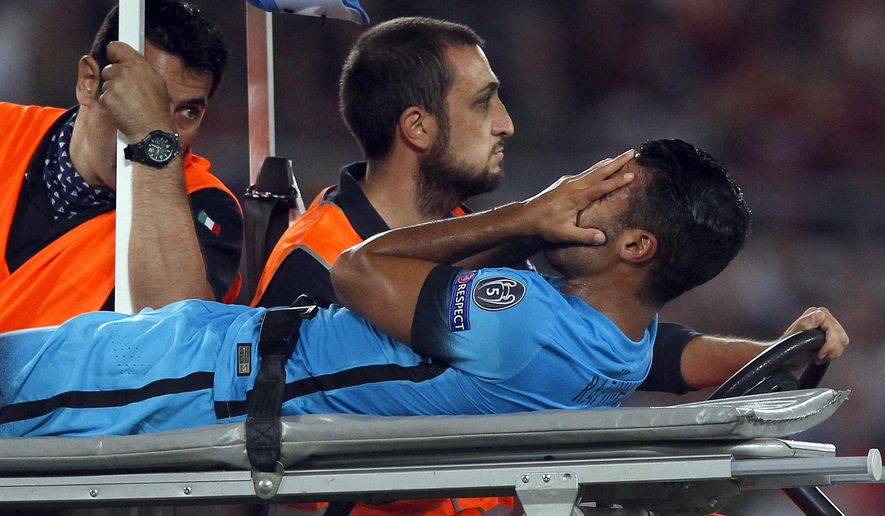 Barcelona's Rafinha Alcantara is carried off the pitch after getting injured during a Champions League, Group E soccer match between Roma and Barcelona, at Rome's Olympic stadium Wednesday, Sept. 16, 2015. (AP Photo/Riccardo De Luca)