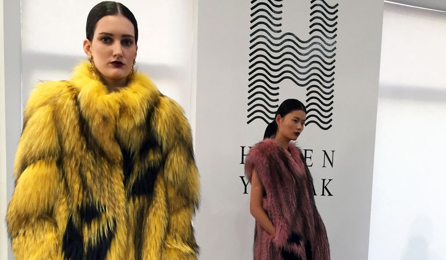 Models wear fur coats by Helen Yarmak at a presentation during Fashion Week in New York in 2015. (AP Photo/Leanne Italie) **FILE**