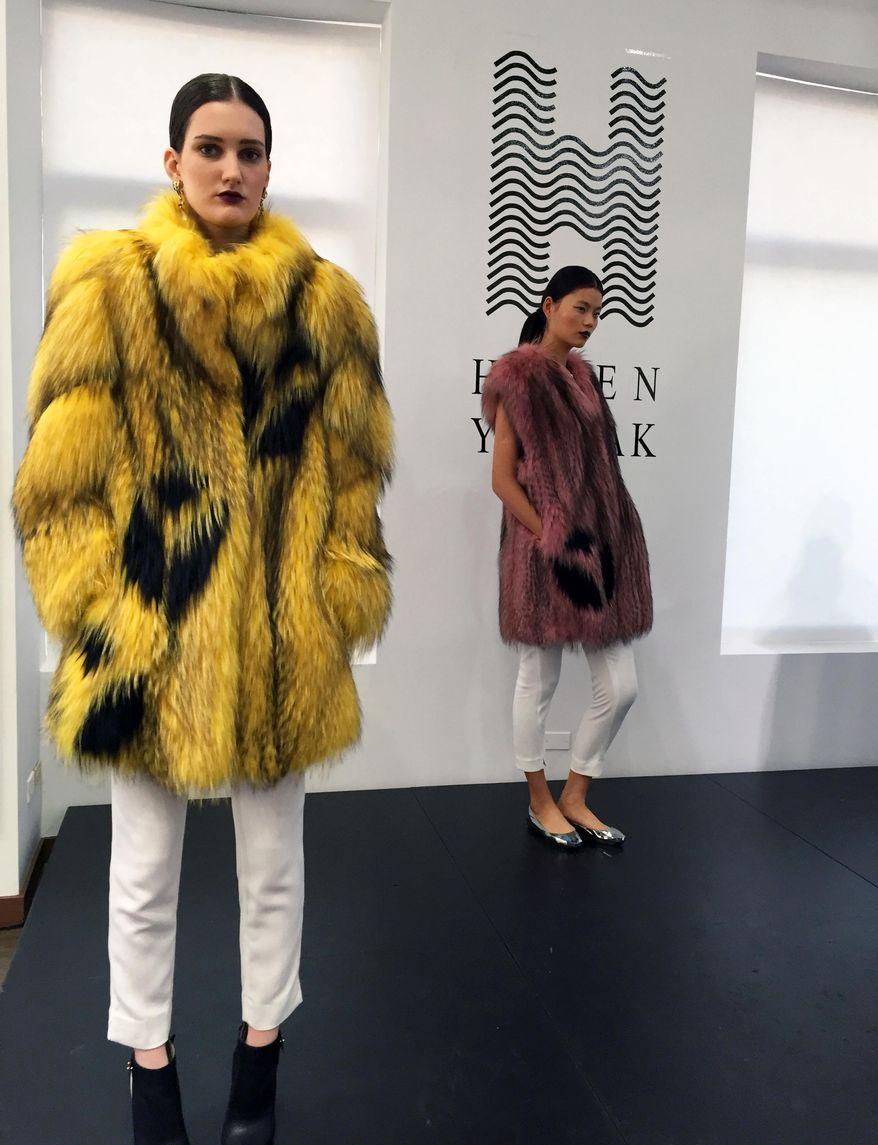 Models wear fur coats by Helen Yarmak at a presentation during Fashion Week in New York in 2015. (AP Photo/Leanne Italie) **FILE**