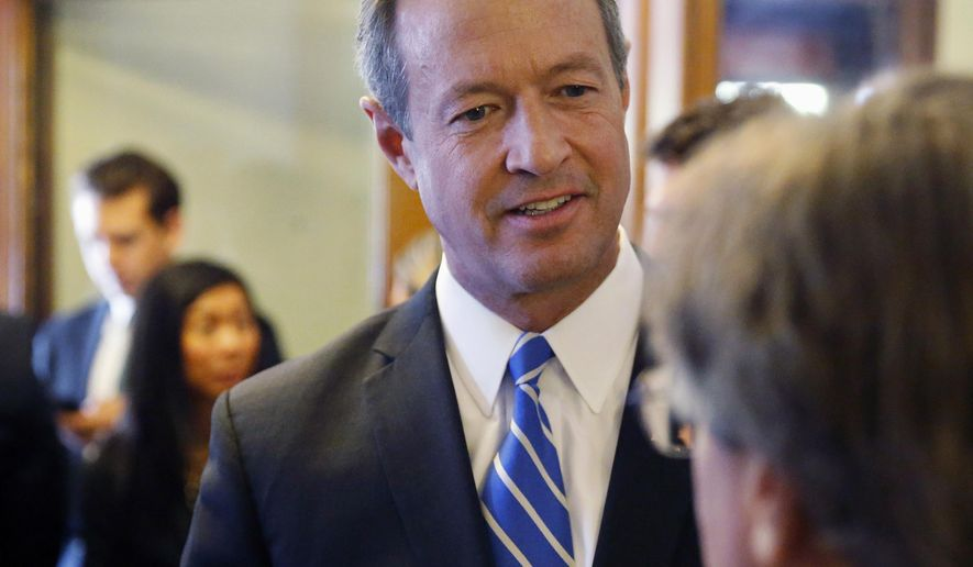 Democratic presidential candidate, former Maryland Gov. Martin O'Malley, left, talks with an attendee at a round table meeting in Denver, Thursday, Sept. 17, 2015. O'Malley met with Colorado officials and marijuana activists and business owners in Denver Thursday, where he repeated his pledge to reclassify marijuana under federal drug laws if elected. (AP Photo/Brennan Linsley)