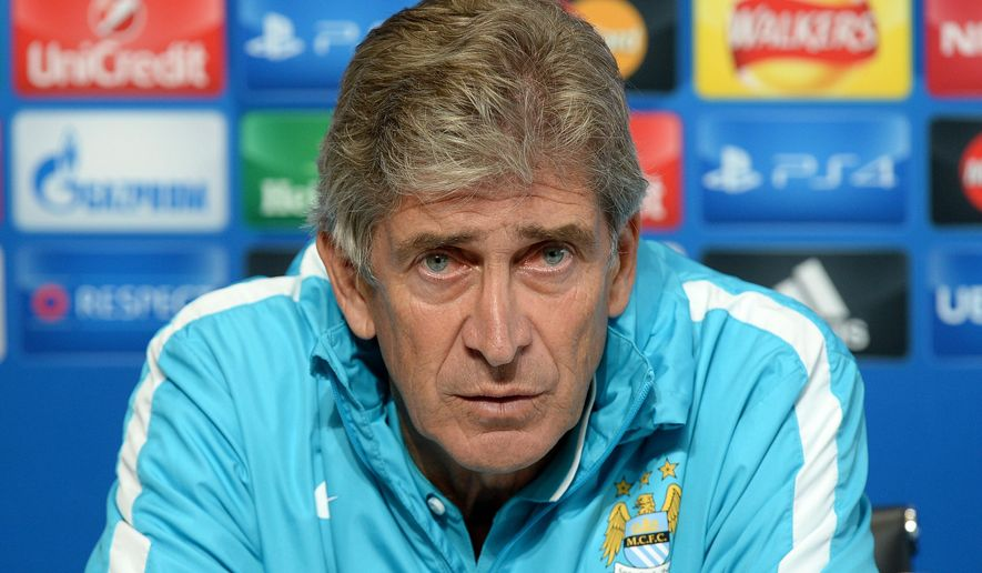 Manchester City manager Manuel Pellegrini during a press conference at the CFA Training Complex, in Manchester, England, Monday Sept. 14, 2015.  Manchester City will play Juventus in a Group D Champions League soccer match on Tuesday. (Martin Rickett/PA via AP) UNITED KINGDOM OUT