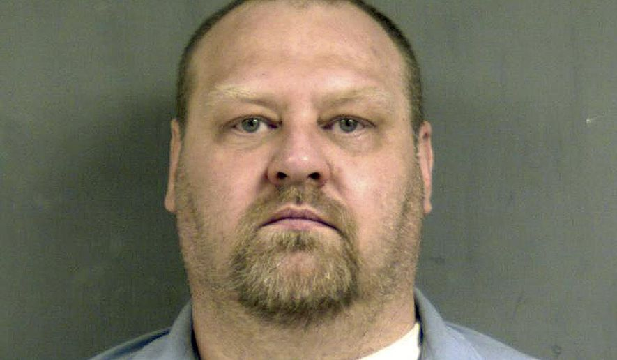 FILE - This undated file photo provided by the Connecticut Department of Correction on May 12, 2015, shows inmate William Devin Howell. Police said Howell will be charged Friday, Sept. 18, 2015, with the serial slayings of six people, whose bodies were found behind a strip mall in New Britain, Conn. Howell was already in prison for killing a woman. (Connecticut Department of Correction via AP)