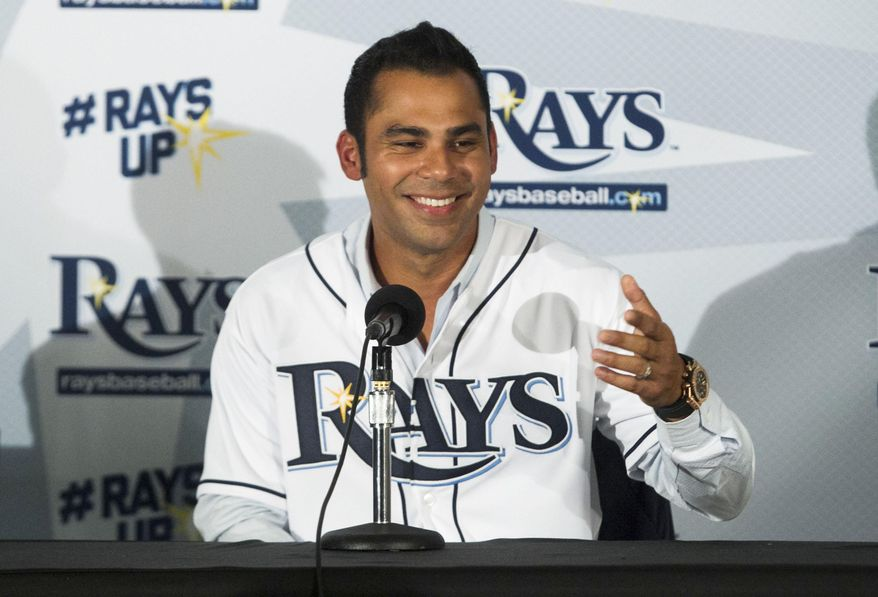 Former Tampa Bay Rays first baseman Carlos Pena speaks after signing an honorary contract to retire as a member of the Rays during a news conference Friday, Sept. 18, 2015, in St. Petersburg, Fla. (Will Vragovic/The Tampa Bay Times via AP)  TAMPA OUT; CITRUS COUNTY OUT; PORT CHARLOTTE OUT; BROOKSVILLE HERNANDO TODAY OUT; MANDATORY CREDIT