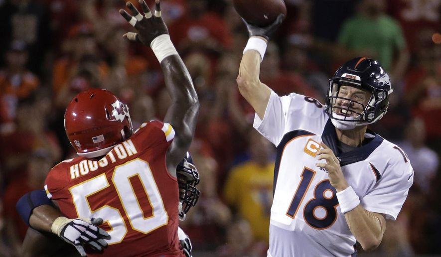 Denver Broncos quarterback Peyton Manning (18) throws under pressure from Kansas City Chiefs linebacker Justin Houston (50) during the second half of an NFL football game in Kansas City, Mo., Thursday, Sept. 17, 2015. (AP Photo/Charlie Riedel)