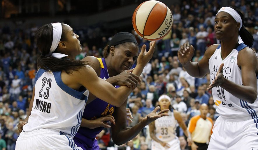 Minnesota Lynx forward Maya Moore (23) knocks a rebound away from Los Angeles Sparks center Jantel Lavender as Lynx center Sylvia Fowles (34) keeps an eye on the ball during the first half of Game 1 of the WNBA basketball Western Conference semifinals in Minneapolis, Friday, Sept. 18, 2015. (AP Photo/Ann Heisenfelt)